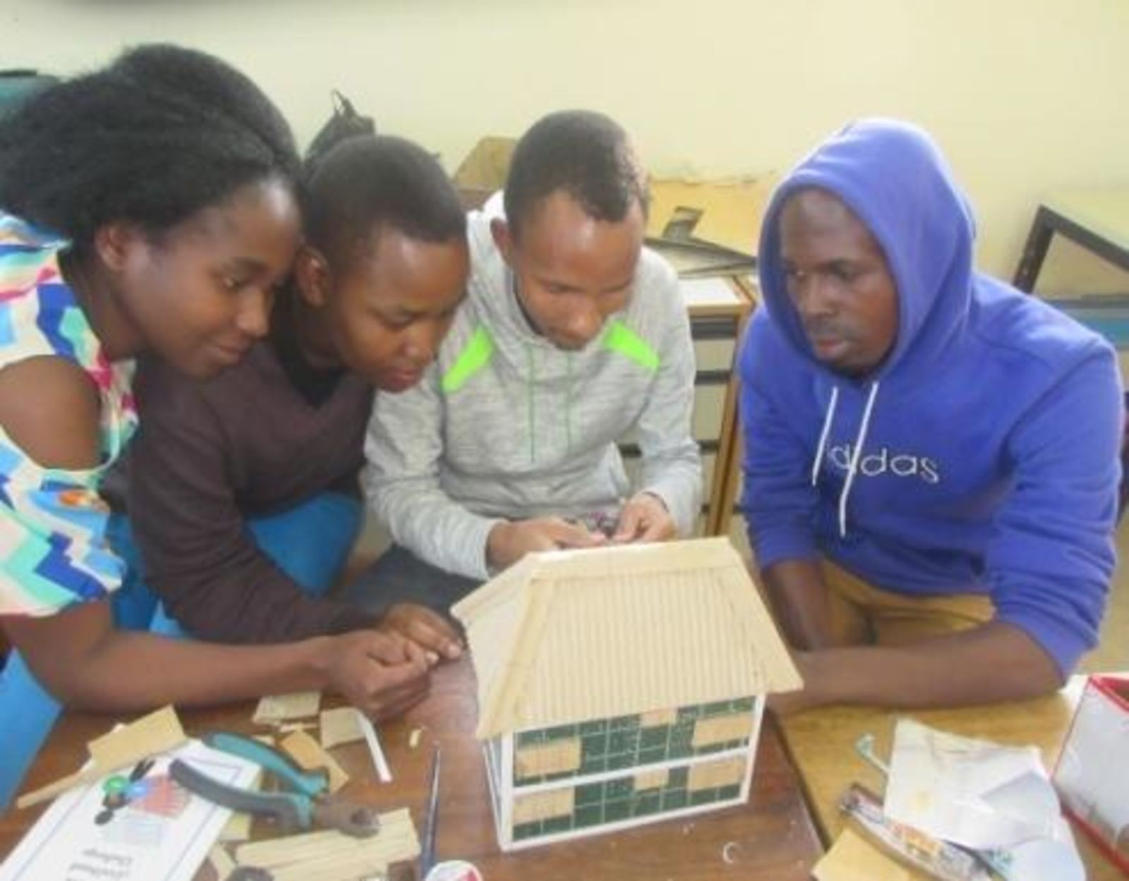 Creative livelihood challenge training students work on their prototype developed during the training lg